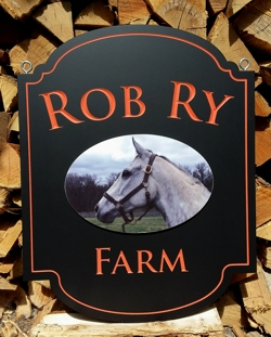 Custom farm sign in rich red and gold leaf carved letters