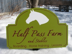 Custom equine farm sign with calligraphic carved letters