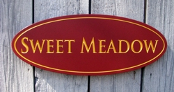 Custom carved wood sign with gold painted lettering