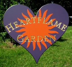 A very unique heart shaped sign gold leaf and purple background