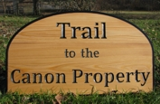Custom wood sign in cypress for a trail