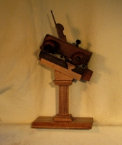 Beautiful antique plow plane mounted onto a custom stand