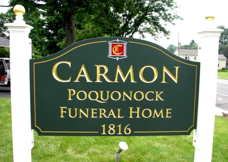 Custom business sign for a local funeral home. Lettering is in gold leaf.