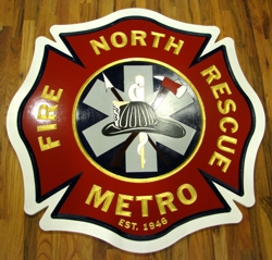 Custom carved fire station sign with gold leaf lettering