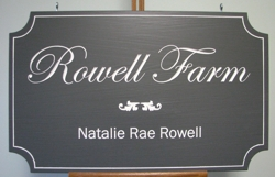 District custom carved sign with cursive font on solid oak wood.
