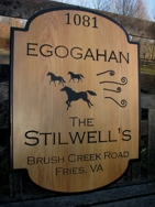 Custom wood sign made of cypress. Black carved lettering.