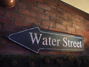 This handpainted sign is part of a set that adornes the wall of a converted old brick factory