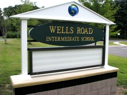 Monument sign for a local school. Double sided with 3 line message board