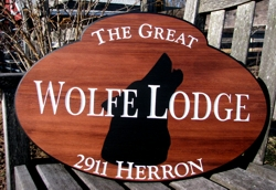 Ellipse carved sign made of cypress natural finish white lettering