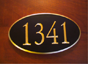 A beautiful oval carved wood sign with special request to have gold leaf on the edges