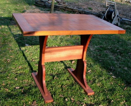 Contemporary industrial table made out of mahogany, all custom made for a nook